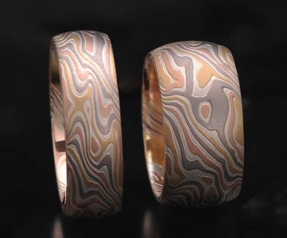 a pair unique mokume wood grain metal rings