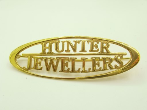 company logo brooch gold or silver